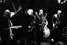 Lol Coxhill, Elton Dean, Evan Parker, Simon Picard; also John Edwards (lurking in the background with the double bass), Mark Sanders (not visible)